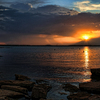 Evening calm settles in over a rocky shoreline of Lake Eufaula after a summer storm.