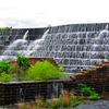 The spillway at Dripping Springs Lake in Okmulgee State Park is a beautiful spot after a rain or any time water is cascading over the down the walls.