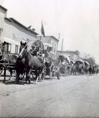 A parade of covered wagons makes its way along Oklahoma Avenue in Guthrie to celebrate Pioneer Day in April 1912.  The event, now known as 89ers Day, celebrates the heritage of the pioneers who made the land run into Guthrie on April 22, 1889.