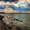 Rays of sun streaming through the clouds create a heavenly scene over Lake Eufaula.  Lake Eufaula is home to Lake Eufaula State Park and the Arrowhead Area at Lake Eufaula State Park as well as several marinas, campgrounds and attractions.