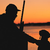 Experience the powerful beauty of an Oklahoma sunrise with your hunting buddy.