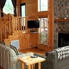 The charming cobblestone fireplace welcomes guests to the Spokane Cabin at Beavers Bend Log Cabins in Broken Bow.