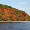 Colorful fall foliage adorns the wooded shoreline of Grand Lake in northeast Oklahoma.