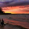 A windy sunset at Lake Eufaula displays colorful bands of clouds along with a rosy glow on the evening waves.
