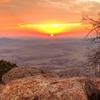A magnificent sunset bathes the Oklahoma landscape in fiery colors as seen from atop Mount Scott in the Wichita Mountains Wildlife Refuge near Lawton.