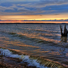 Small waves roll in as a beautiful sunset yields to dusk at Lake Eufaula.