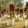 Christmas wreaths adorn the poignant Field of Empty Chairs at the Oklahoma City National Memorial & Museum where each chair represents a life lost in the bombing of the Murrah Building.