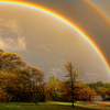 A sensational double rainbow lights up the sky over a cove of Lake Eufaula after a spring storm.