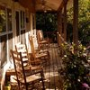 Relax and sit a spell on the lovely porch at Stardust Inn Bed & Breakfast nestled in the Wichita Mountains in Medicine Park.