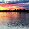 A colorful and scenic sunset over Veterans Lake in the Chickasaw National Recreation Area in Sulphur.