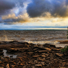 A stormy morning creates a picturesque scene as waves roll into the rocky shoreline of Lake Eufaula.