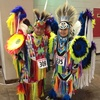 Two dance contestants pay homage to their heritage with vibrant regalia at the annual Red Earth Festival in Oklahoma City.