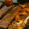 The barbecue professionals at the Rock 'N Rib Festival in Tulsa use special recipes to cook their ribs to perfection.