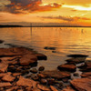 Sunset on the rocks - the rocky shoreline of a Lake Eufaula cove is bathed in the rich colors of sunset.