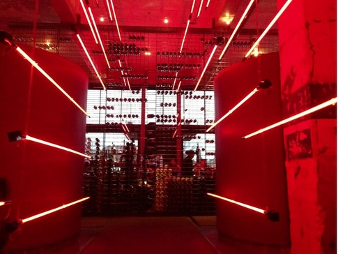 Red PrimeSteak in downtown Oklahoma City is famous for its suspended tubes of red lighting, which bathe the restaurant in sultry red tones.