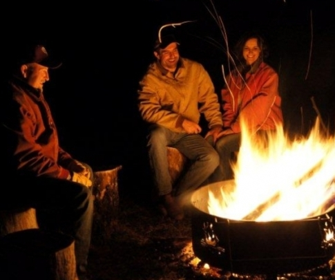 Guests gather around a blazing campfire at Buffalo Creek Guest Ranch in southeast Oklahoma.