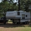 Little Pine Cabins & RV in Atoka Sites offers plentiful shaded spots for RV camping in the warm summer months.