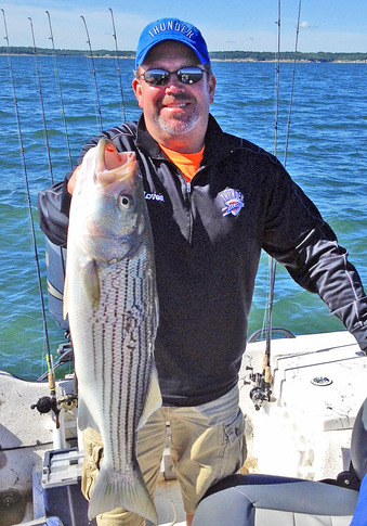 A happy angler shows off a nice Lake Texoma striper.