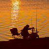 This fisherman is up at dawn and ready to make a big catch near Norman.