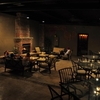 A large patio with glowing fireplace makes Vintage 22 in Ada the ideal place to enjoy a meal in any season.