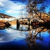 The picturesque creek running through Medicine Park creates a perfect reflection of the quaint bridge.