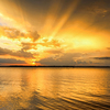Golden rays bathe Lake Eufaula in an alluring glow at day's end.