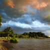 When storms approach, the light can be enchanting in Oklahoma as this photo of a Lake Eufaula cove shows.