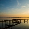 A dock stretches into Lake Murray, creating the perfect place to watch the sun go down over Lake Murray State Park.