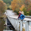 A couple enjoys the fall foliage along the Lower Mountain Fork River in Beavers Bend State Park.