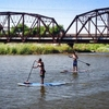 Learn how to stand up paddleboard with Flat Tide and head out on Lake Overholser or explore the Stinchcomb Wildlife Refuge in Oklahoma City.