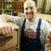 The founder of Marshall Brewing Company, Eric Marshall, holds up one of his most acclaimed beers.