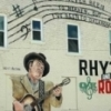 "Duncan Convention & Visitors Bureau commissioned Palmer Studios to create this ""Rhythm & Routes"" mural, featuring Hoyt Axton, Mae Boren-Axton and Elvis Presley."