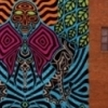"Artist Rick Sinnett created this ""Three Days"" mural on the walls of a local business in downtown Norman."