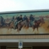 Alva Mural Society commissioned local artists to paint a depiction of a historic 1878 scene, represented in this Battle of Turkey Springs Mural.