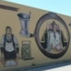 "Palmer Studios painted this ""Yesterday's Commerce"" mural in Historic Downtown Edmond, near where Dr. Bob Palmer once taught art and mural painting courses."