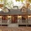 The Maison de Crique Cabin offered by Hidden Hills Cabins in Broken Bow is a gorgeous French inspired cottage on the creek.