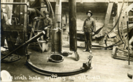 Oil workers drill an oil well in 1918 Cushing.