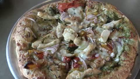 Top That! Pizza offers personalized, topping-heavy pizzas in Tulsa.