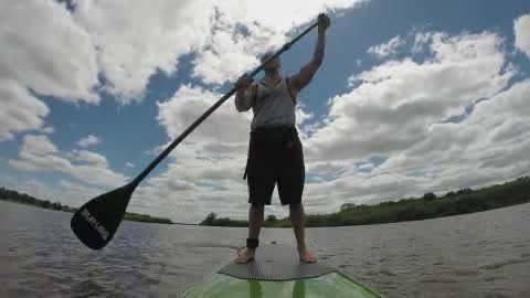 Learn how to paddleboard with Flat Tide in OKC.