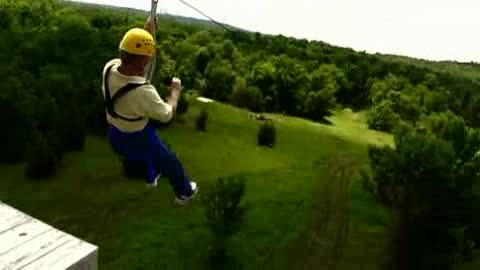 Zip line through the trees of Tulsa with POSTOAK Canopy Tours.