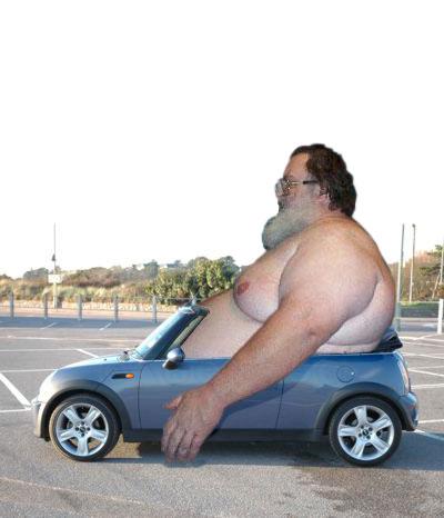 File:225629 fat guy in car.jpg