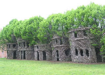 Explicit shaping of vines make primitive two story huts (c/o http://wildhunt.org/blog/2006/02)
