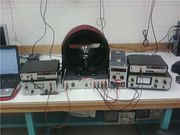 Picture M1.  A picture of the total apparatus, with all three power supplies and both multimeters. This photograph was taken by Alexandra Andrego and Anastasia Ierides