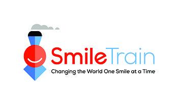 SmileTrain CMYK Primary logowithtagline fullcolor.jpg