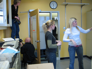 Midwife team (at door) attending birth of -80 through tiny opening into new lab in MRB. Stacie and Alex direct traffic.