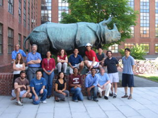 Harvard 2007 iGEM team Kneeling (L-R): Nicholas Guido, George Xu, Stephanie Lo, Ellenor Brown, Shaunak Vankudre, Alain Viel Standing (L-R): Pamela Silver, George Church, Debra Auguste, Bill Senapedis, William Shih On Statue (L-R):  Mike Strong, Tamara Brenner, Perry Tsai, Kevin Shee, Harris Wang