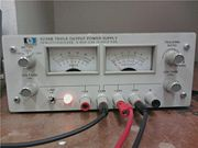 THE TRIPLE OUTPUT POWER SUPPLY