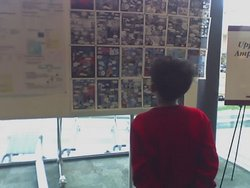 Figure 0. Becky Ward's candid of one of the younger 2005 ICSB conferees considering an early color draft of the comic.