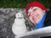 Susannah R Payne with tiny snowman during Snow Day 2007