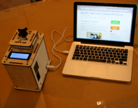 Snapshot of an OpenPCR plugged into a computer.